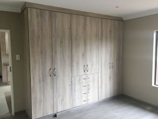 TCC interior projects cc BedroomWardrobes & closets Chipboard Wood effect