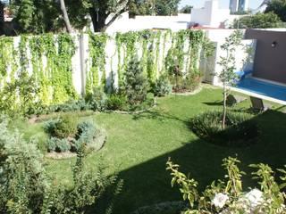 CASA VINTAGE ARQUIMIA ARQUITECTOS Jardines clásicos de Arquimia Arquitectos Clásico