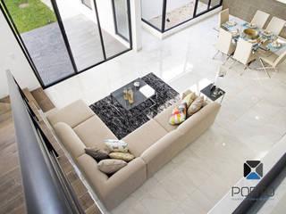 PORTO Arquitectura + Diseño de Interiores Soggiorno moderno