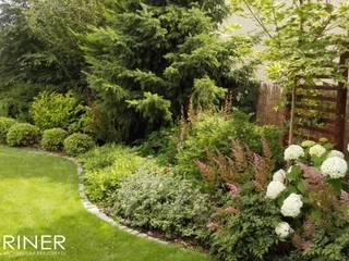 Ogród w angielskim stylu od GRINER Architektura Krajobrazu