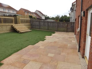 Sandstone paving area.:  Garden by Bradshaw contracts ltd