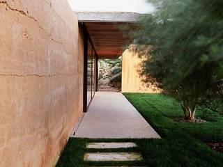 Jardines rústicos de Paul Marie Creation Garden Design & Swimmingpools Rústico