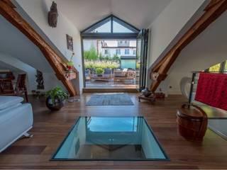 Villa Lisa - Duplex: Salon de style de style Moderne par EURL Atelier d'Architecture Michel Nicoletti