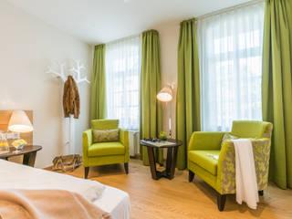 Neue Hotelzimmereinrichtung BAUR WohnFaszination GmbH Moderne Hotels Holz Grün