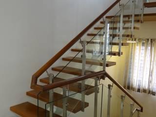 Residence of Mr.Manjunath Modern corridor, hallway & stairs by Hasta architects Modern