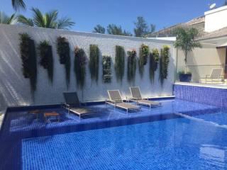 GEA Arquitetura Piscina in stile tropicale