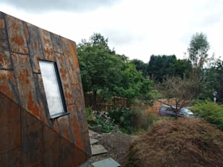 The rear extension clad in Corten steel:  Houses by Woodside Parker Kirk Architects