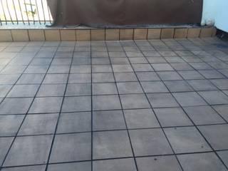 Solado en terrazas - Lechada negra Fecofer, Proyectos y Reformas Paredes y suelos de estilo rústico Gris