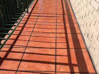 Solado en terrazas - Lechada negra Fecofer, Proyectos y Reformas Paredes y suelos de estilo rústico Naranja