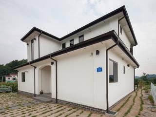 윤성하우징 Casas estilo moderno: ideas, arquitectura e imágenes Gris