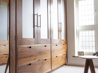 Dressing room - Fitted walnut wood cabinetry :  Bedroom by Baker & Baker