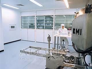 Pisos Industriales: Clínicas / Consultorios Médicos de estilo  por Adoria Aplicaciones Técnicas