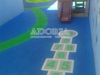Pisos de seguridad Infantil y deportivos: Escuelas de estilo  por Adoria Aplicaciones Técnicas