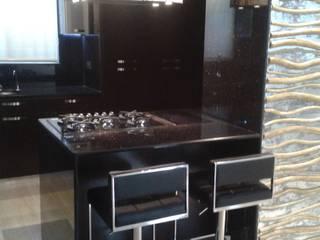 APARTAMENTO EN RESIDENCIAS SANTA LUCIA. CelyGarciArquitectos Muebles de cocinas Granito Negro