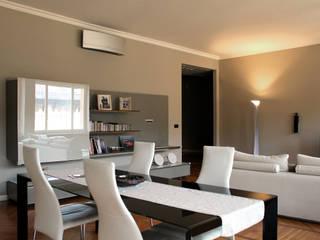 Via Magenta Onice Architetti Sala da pranzo moderna Legno Bianco