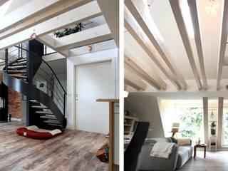 Wohnhaus PH - Umbau einer Dachgeschosswohnung:  Wohnzimmer von Architekturbüro Schumann