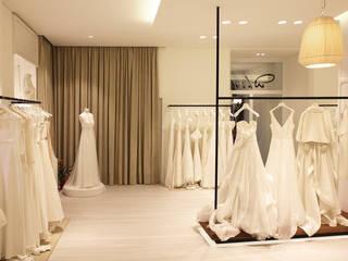 White Le Spose Onice Architetti Negozi & Locali commerciali moderni Legno Bianco