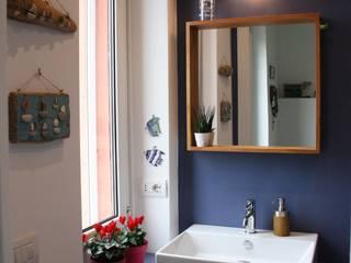 Baños de estilo ecléctico de studio ferlazzo natoli Ecléctico