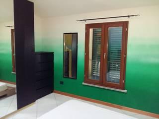 Una camera effetto natura Camera da letto in stile classico di Interno5 Classico