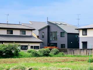 Rustic style house by &lodge inc. / 株式会社アンドロッジ Rustic