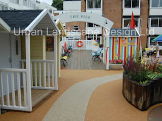Seaside Garden with Beach Huts & Pier: classic Garden by Urban Landscape Design Ltd