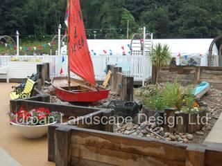 Seaside Garden with Beach Huts & Pier:  Garden by Urban Landscape Design Ltd