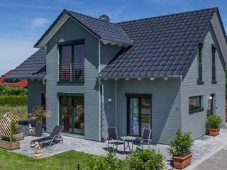 Casas de estilo  de KitzlingerHaus GmbH & Co. KG