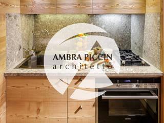 Ambra Piccin Architetto Rustic style kitchen Wood Amber/Gold