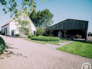 Landelijke tuin Dussen: landelijke Tuin door De Rooy Hoveniers