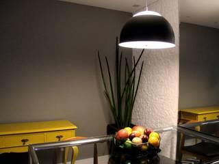 sala prática por Lúcia Vale Interiores Eclético