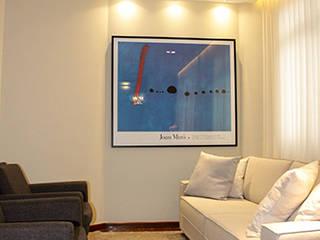 Salas / recibidores de estilo  por Novità - Reformas e Soluções em Ambientes, Moderno