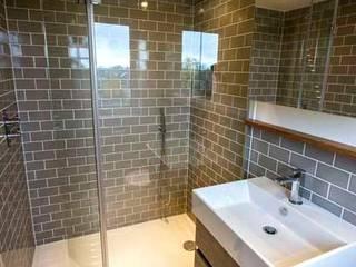 Loft & Extension, Raynes Park Cube Lofts Modern bathroom