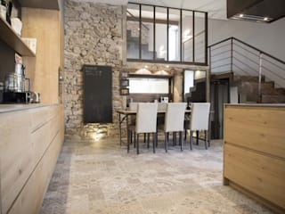 Industrial style dining room by réHome Industrial Stone