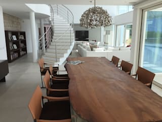 Villa Vale Telheiro: Salas de jantar  por Pure Allure Interior,Moderno