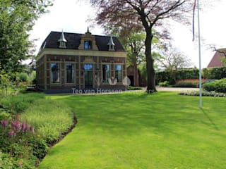Country style garden by Teo van Horssen Hoveniers Country
