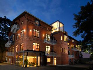 RONALD-KIRSCH PLANungsgesellschaft Casas de estilo industrial Ladrillos Multicolor