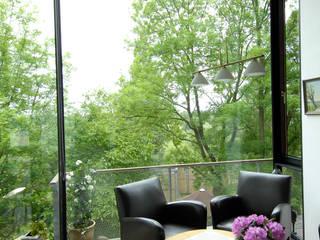 RONALD-KIRSCH PLANungsgesellschaft Salas de estilo industrial Vidrio Multicolor