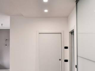 ห้องโถงทางเดินและบันไดสมัยใหม่ โดย M16 architetti โมเดิร์น