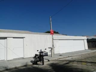 Reforma de residência: Casas  por Hilda Paiva arquitetura e construção Ltda