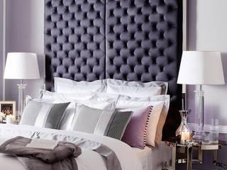 Camera da letto in stile  di Conexo.