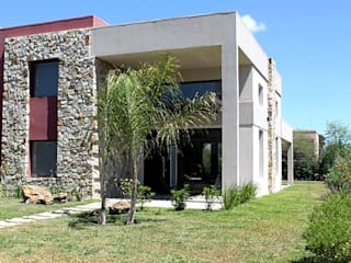 Modern houses by AM Estudios Modern