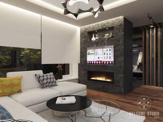 Таунхаус «Dark Wood» в котеджном посёлке «Альпийский»: Гостиная в . Автор – Мастерская дизайна Welcome Studio, Модерн