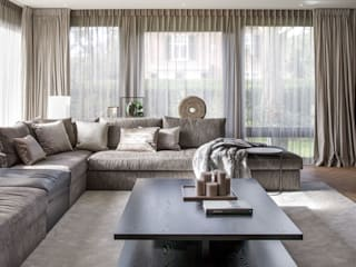 Living room by choc studio interieur, Modern
