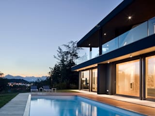vista sulle colline: Case in stile  di iarchitects