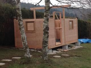 Construction d'une chambre d'amis : chalet en douglas. Chambre moderne par Atelier Bois Dlilio Moderne
