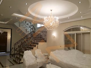تشطيب فيلا K مدينتي -القاهرة :  غرفة المعيشة تنفيذ شركة زمزم للتصميم و التفيذ المعماري