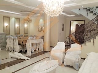تشطيب فيلا K مدينتي -القاهرة :  غرفة السفرة تنفيذ شركة زمزم للتصميم و التفيذ المعماري