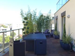 Salon de jardin gain de place: Terrasse de style  par Skéa Designer