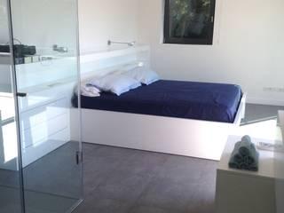 Reforma Casa Unifamiliar Dormitorios de estilo moderno de Artecnics Rehabilitació Moderno