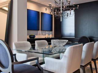 Modern dining room by Studio Leonardo Muller Modern